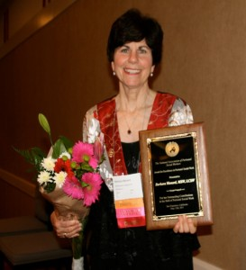 Barbara Menard receives NAPSW Award